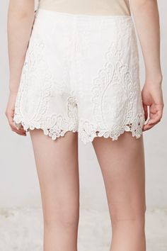 Love this lace! I could find solid color shorts I like the fit of, and do a lace overlay that hangs below the hem.  Calvi Lacework Shorts - Anthropologie.com