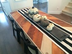 Halloween decor.  Handmade chalk server with a collection of white pumpkins.