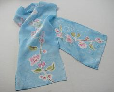 SOLD. $45 – Spring inspired cherry blossom scarf with baby blue background.