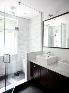 Clean lines--dual vessel sinks, white/grey tile, and dark wood.