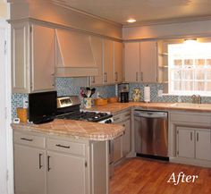 Awesome idea! Can't take out the soffet? Paint the soffet the same color at the cabinets and add some molding.