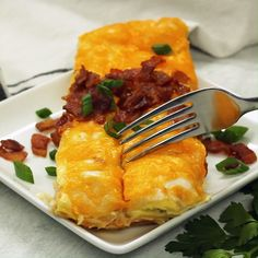 Jump to Recipe Print RecipeThese Breakfast Enchiladas combine a much loved Tex Mex fav with classic AM flavors Soft flour tortillas are stuffed with a savory meat mixture, and topped with a rich egg custard, crisp bacon bits, and shredded cheddar W - p Mexican Food Recipes, Dinner Recipes, Mexican Breakfast Recipes, Brunch Recipes With Bacon, Breakfast Sandwich Recipes, Turkey Recipes, Chicken Recipes, Breakfast Enchiladas, Hashbrown Breakfast