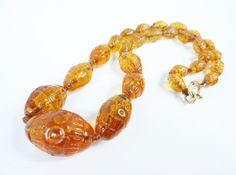 Vintage Amber Barrells Necklace with Hand by PopAndGlamVintage