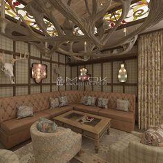 Интерьер гостиной с элементами из жаккардовых тканей и чехлами для подушек в стиле шале