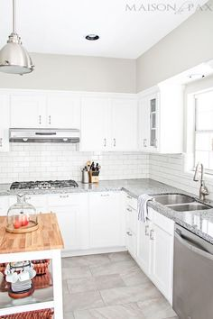 gorgeous classic white kitchen renovation (counters are Azul Platino Granite) maisondepax.com