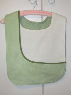 Pockets to hold small items and warm hands.  Fabric used: fleece and winter sheeting on the back