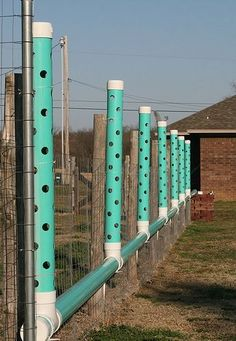 Outdoor hydroponic fence towers