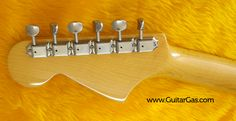 Vintage style tuners on the headstock of a crafted in Japan Fender Jaguar