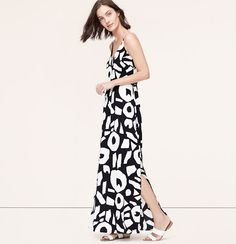 """In a gracefully strappy silhouette, this bold-printed piece really shapes up the season. V-neck. Spaghetti straps. Shirred elasticized waist. V back with strap. Lined bodice, unlined skirt. 39"""" from waist seam."""