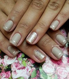 Gray and silver French tips. Accentuate your nails but adding stencil and silver glitter polishes on the matte gray base.