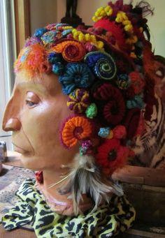 ceramic bust with freeform crochet hat by Dora Siemel