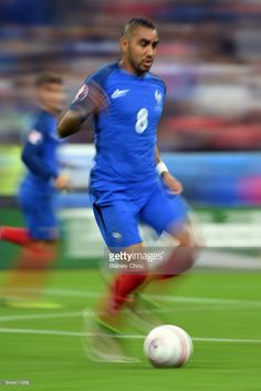 Dimitri Payet of France runs with the ball during the UEFA EURO 2016 quarter final match between France and Iceland at Stade de France on July 3, 2016 in Paris, France.