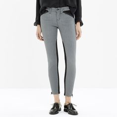 """Madewell colorblock zip jeans Grey skinny jeans with black details on the pockets and legs. Zippers on the ankles, back pockets, and front pockets. No trades.                  •Fitted through hip and thigh, with a slim leg. •Inseam: 28"""". •Leg opening for size 25: 9 3/4"""". •93% cotton/5% poly/2% spandex. •Machine wash. •Import.❌NO TRADES.✔️ Feel free to Ask questions. ✔Offers are welcome. Madewell Jeans Skinny"""