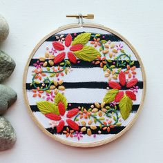 Check out this item in my Etsy shop https://www.etsy.com/listing/290278995/hand-embroidered-mini-floral-wreath-5