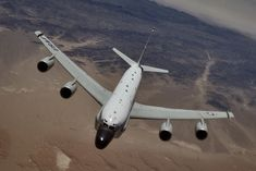 An RC-135 Rivet Joint reconnaissance aircraft moves into position behind a KC-135 Strato-tanker for aerial refueling.