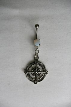 The Wanderer Compass Belly Navel Ring in Opal. $10.00, via Etsy.