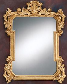 beautifully wood-carved mirror frame