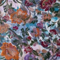 The runways were filled with Asian-inspired prints and fabrics, so we're pleased to offer this chinoiserie-style floral brocade. It features orange and red flowers against a soft blue, watercolor background, with shimmering gold metallic hightlights. Medium-weight with a stiff drape, the fabric would make exotic kimonos, robes, jackets, dresses and more.