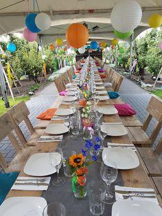 Dineren in de tuin aan een stoere steigerhoutentafel.