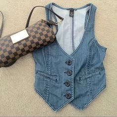 H&M denim Fashion Top! Very fashionable denim vest/top! Could be used to layer or wear in the spring with just a tank! This is too small for me... Size 2! Will ship next day. Please use offer button price negotiable!!! H&M Tops