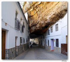 """The Amazing Rock City in Setinil, Spain - Setenil de las Bodegas is about 18 km away from Ronda in the province of Cadiz, has wedged itself between the cliffs eroded by the Rio Trejo river.    That""""s crazy!"""