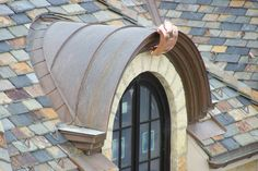 radius seamed valley to a copper barrel roof dormer with an ornamental cresting