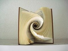 Discover the Art of Book Folding with Our Selection of 85 Photos With Tutorials and Videos %%page%% - Architecture + Ideas for Folded Book Art Including 85 Photos and Tutorials is part of DIY Book Art Shape - Folded book art is a new form Folded Book Art, Paper Book, Paper Art, Paper Crafts, Old Book Crafts, Book Page Crafts, Altered Book Art, Book Sculpture, Paper Folding