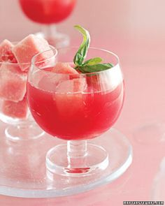 """After a stay in the freezer, cubes of watermelon become """"ice"""" for this margarita, which gets an herbal edge from basil-infused tequila.Get the Watermelon-Basil Margaritas Recipe Craft Cocktails, Fun Drinks, Yummy Drinks, Beverages, Colorful Drinks, Sangria Recipes, Margarita Recipes, Cocktail Recipes, Watermelon Margarita"""