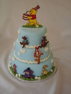 Winnie the Pooh cake - all figures are chocolate transfers - use buttercream transfer technique with coloured chocolate.