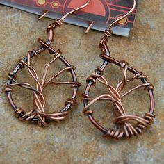 Use a heavy wire for the tree for a pendant. Tree of Life Copper Earrings