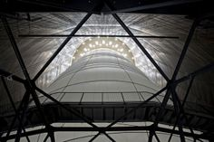 Big Air Package / Christo and Jeanne-Claude  A massive inflated balloon erected inside the Gasometer Oberhausen, Germany is purported to be the largest inflated envelope suspended without a skeleton. Designed and installed by artists team Christo and the late Jeanne-Claude, Big Air Package is a radical play of both space and light, pushing the limits of scale for a temporary installation.