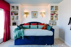 Little Boy's Room with Built-In Bookcases and Daybed - love how it will transition as the child grows!