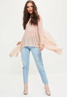 Mesh it up and be the frill of the season in this top. Featuring a blush pink hue, waterfall frill detailing and full mesh fabric - you'll be stealing the spotlight this weekend.