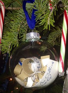 This was a great gift from one of my bridesmaids.  She shredded my wedding invite in to curls and put it in a clear crystal ball ornament.  Great gift idea for newlyweds at Christmas or for their wedding!