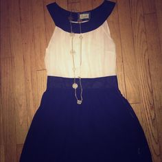 Emmelee navy and cream dress Emmelee navy and cream dress size: small has a small hole at bottom Emmelee Dresses