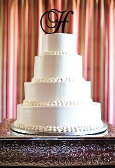 Monogram cake topper. Monogrammed Wedding Cake. Wedding cake. A photo of a wedding at Old Wide Awake Plantation