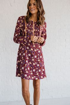The Autumn in Bloom Red Floral Dress is the prettiest dress for the prettiest season. The dark red lightweight fabric is covered with beautiful gold, blue, green, and gray floral and leaves print.