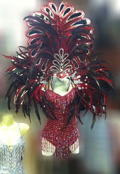 Set includes headdress backpack, and leotard. Hand crafted by our professional headdress makers. Outrageous, over-the-top costume. Comfortable to wear. High quality, strong, and durable.