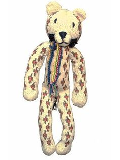 #fairtrade #organic cotton knitted toy tiger.Made by the women fron the Kenana Knitters, a group of rural women who make up a self supporting knitting co-operative in Kenya. The knitted animals are fair-trade and eco-friendly, using naturally coloured wool or organic cottons.So, if you are looking for a fair-trade childrens gift this year, consider these toys, as you will not only give a hand crafted gift that will be treasured, you will be helping make a difference in these knitter's lives.