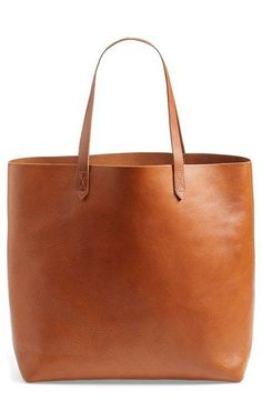 'The Transport' Leather Tote This style is available in inky black or rugged brown and may be monogrammed for a personal finishing touch.