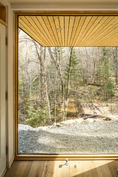 A cantilevered living room offers forest views in this house near Ottawa