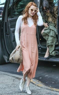 Smells like teen spirit! Emma Roberts rocked 90s grunge in a pink slip dress as she stepped out in New York on Saturday