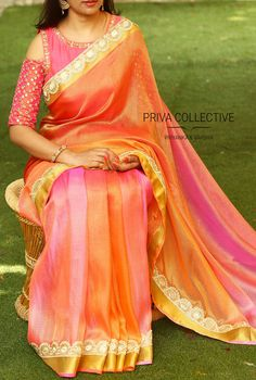 PV 3518 : Orange and pink shadedPrice : 4900RsSteal the show in this classy number this season. Orange and pink shaded tissue kota sari is finished with a tinge of pear 04 October 2017