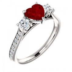 The perfect engagement or anniversary ring for your bride. A x heart-shaped red garnet gemstone is the centerpiece of this three stone ring in white gold. Garnet Jewelry, Garnet Gemstone, Designer Engagement Rings, Diamond Engagement Rings, Three Stone Rings, Red Garnet, Anniversary Rings, Ring Designs, Heart Shapes