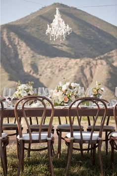 A chandelier glams up any outdoor space ;; wedding space