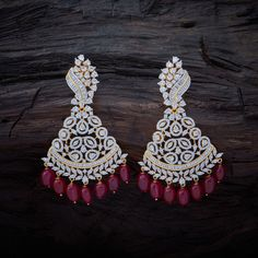 Dazzling CZ Zircon Hanging earrings studded with Ruby synthetic stones, with Rodium Polish.
