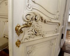 Exquisite details~elegant boiserie in acanthus leaves, scrolls, garland & ribbon with coordinating gilded hardware. Magnificence from the 18th century.