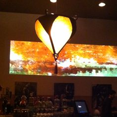 Two screen wide projection on two story wall of bar area at Wang's restaurant in North Park, San Diego. Motion graphic aesthetically designed to work together side by side.