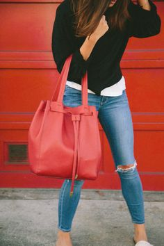 Red Cuyana purse.  Ripped jeans, black sweater.  San Francisco Street Style.  Hillary Jeanne Photography http://www.hillaryungson.com/