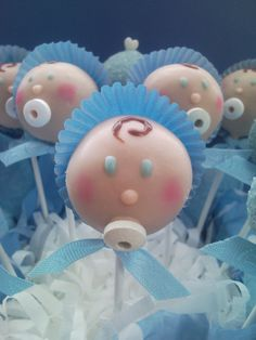 Baby Cake Pops...would be great for a baby shower.  Pink hat and bow for a girl.  Cute!